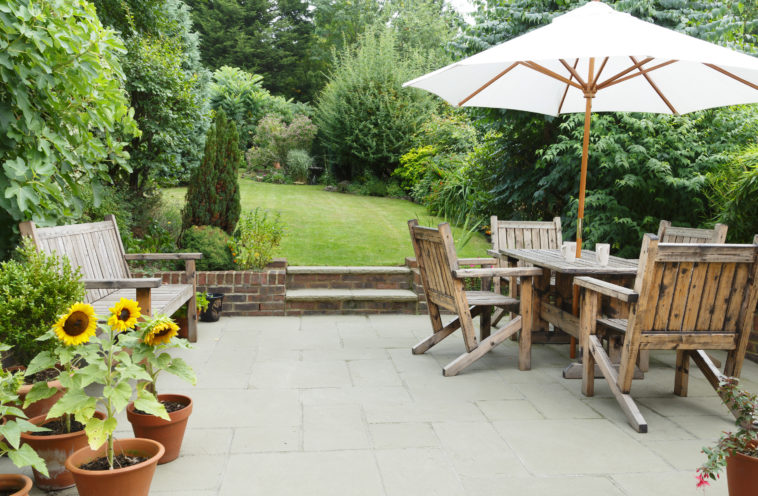 Outdoor sitting room and a garden room beyond.